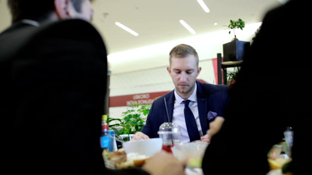 business lunch in cafeteria, handheld shot - canteen stock videos & royalty-free footage