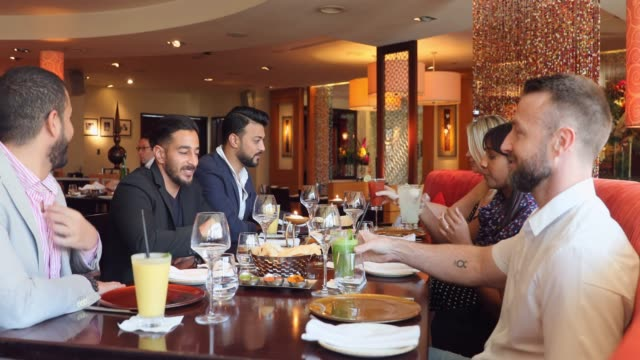 business lunch with a group of colleagues after a successful meeting - business lunch stock videos & royalty-free footage