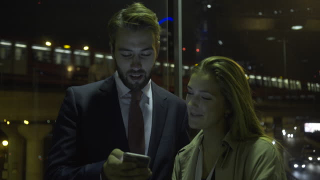 business male on digital tablet in business district - tube stock videos and b-roll footage