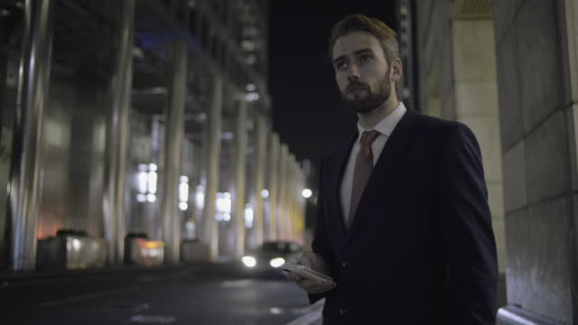 Business male waiting for Taxi outside office