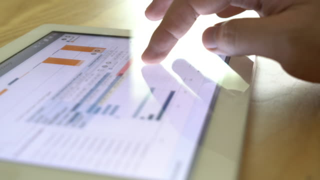 Business man analysing big data on digital tablet