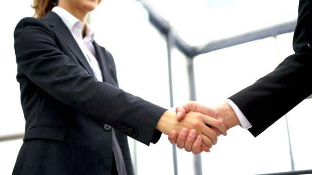 business man and woman handshake at office - dressing up stock videos & royalty-free footage