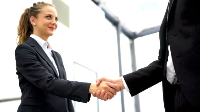 business man and woman handshake at office - formal stock videos and b-roll footage