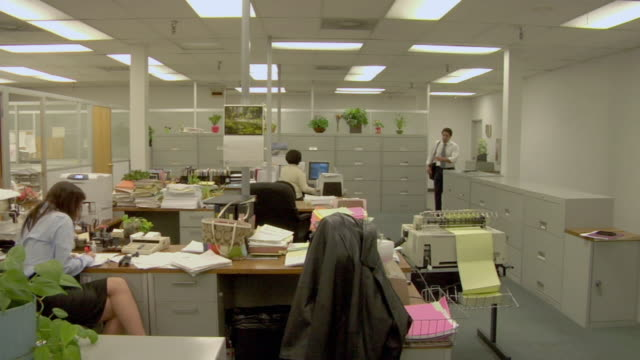 ms, pan, business man arriving in office, compton, california, usa - male with group of females stock videos & royalty-free footage