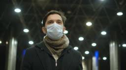 Business Man at Airport Walk. Respiratory Protective Mask on Face. Coronavirus.
