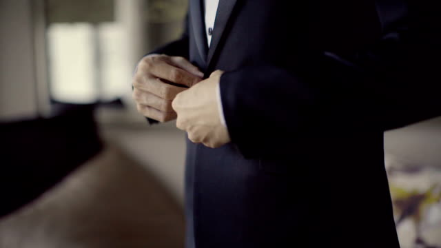 business man buttons his jacket close-up - suit stock videos & royalty-free footage