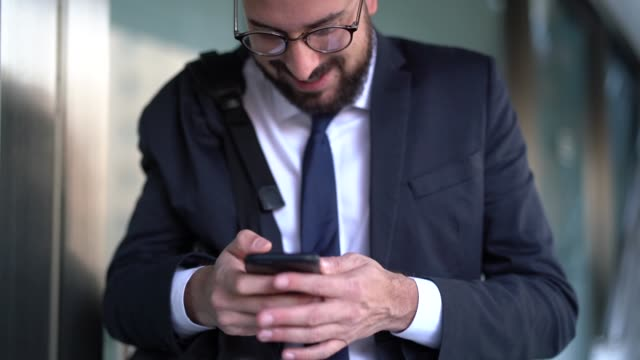 Business Man Celebrating Good News on Mobile