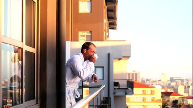 business man early morning coffee - balcony stock videos & royalty-free footage