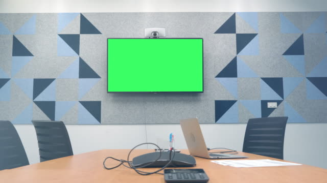 Business man having video conference call with green screen