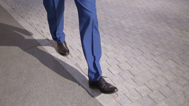 business man in suit taking a big fast step forward - full suit stock videos & royalty-free footage