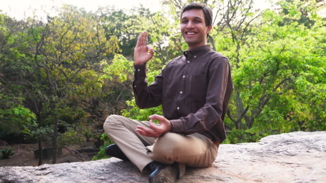 Business man meditating at a Park of India