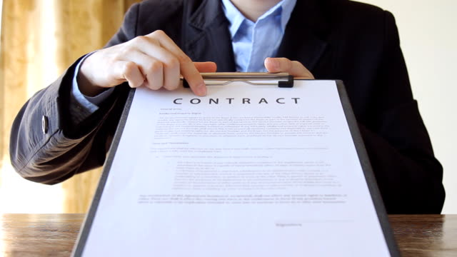 business man offers contract form to the audience - agreement stock videos and b-roll footage