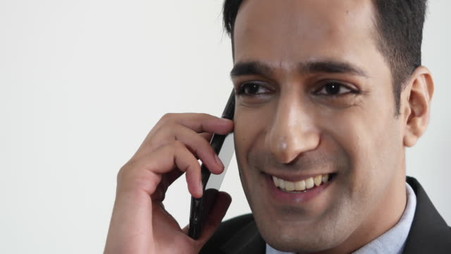business man on a happy phone call - one mid adult man only stock videos & royalty-free footage