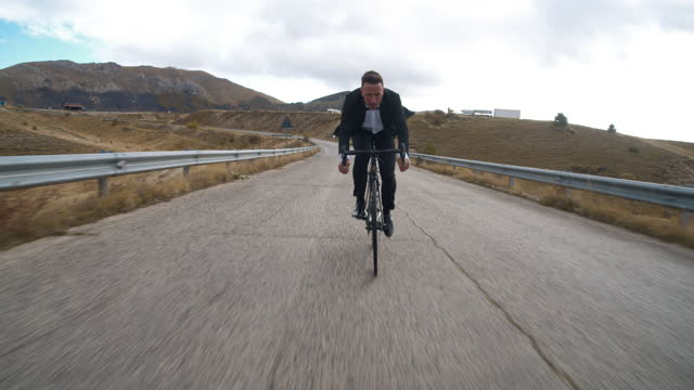 business man on bycicle in campo imperatore - italy - dinner jacket stock videos & royalty-free footage