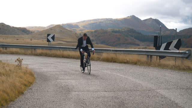 business man on bycicle in campo imperatore - italy - runaway stock videos & royalty-free footage
