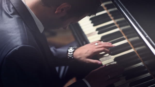 Business Man Playing the Piano