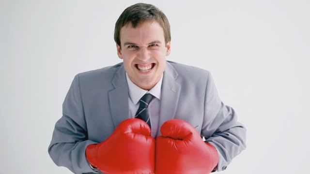 business man playing with red boxing gloves - nur männer über 30 stock-videos und b-roll-filmmaterial