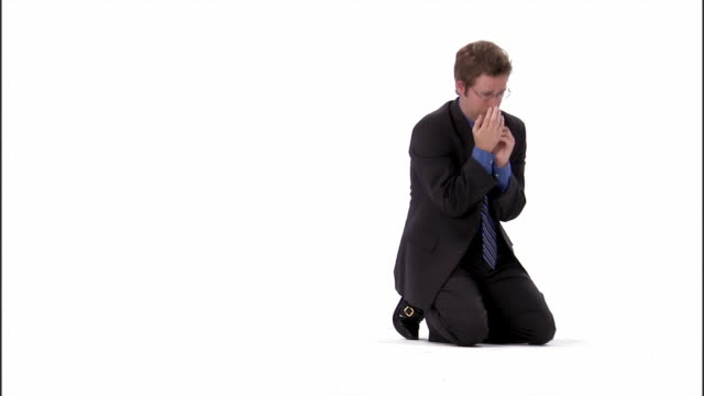 zi, ms, business man praying in studio - kneeling stock videos and b-roll footage