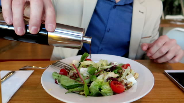 business man put vinegar on his salad - stock video - vinegar stock videos & royalty-free footage