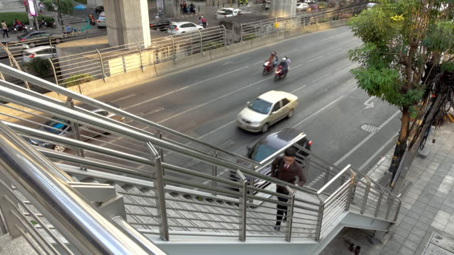 Business man rushing up stairs to work in modern city