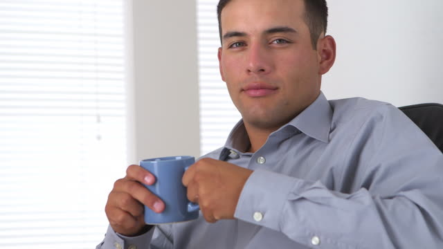 business man sitting with coffee mug in hand - mug stock videos & royalty-free footage