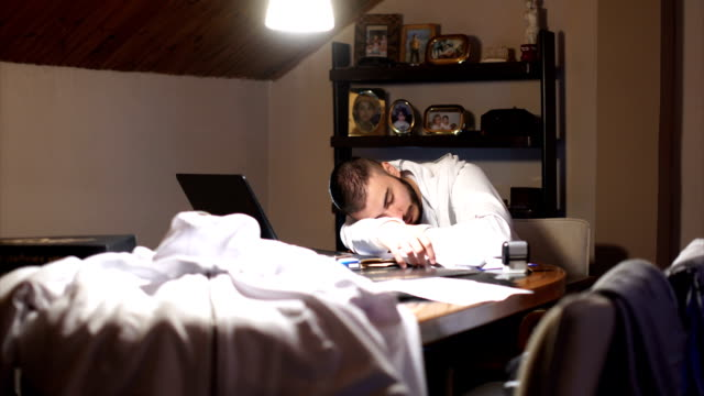 business man sleeping on a paperwork - laziness stock videos & royalty-free footage