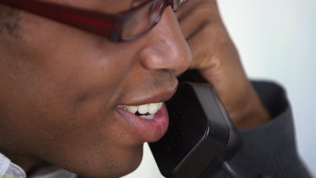 business man speaking on telephone - one mid adult man only stock videos & royalty-free footage