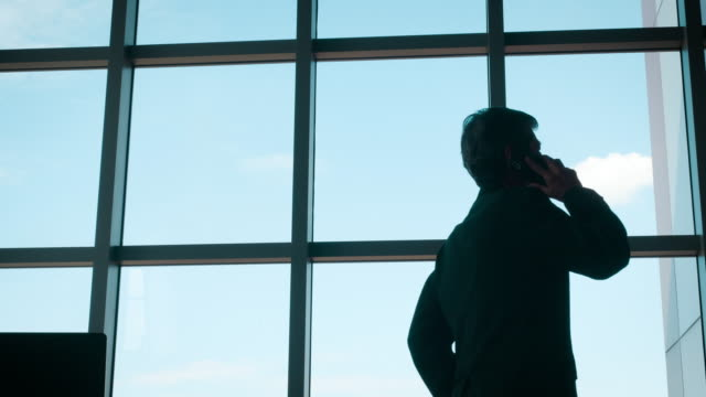business man standing and looking out of windows - chief executive officer stock videos & royalty-free footage