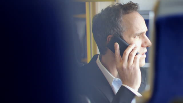cu business man takes a business call - in den vierzigern stock-videos und b-roll-filmmaterial