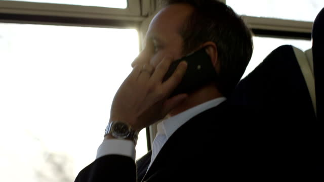 CU Business Man takes a business call