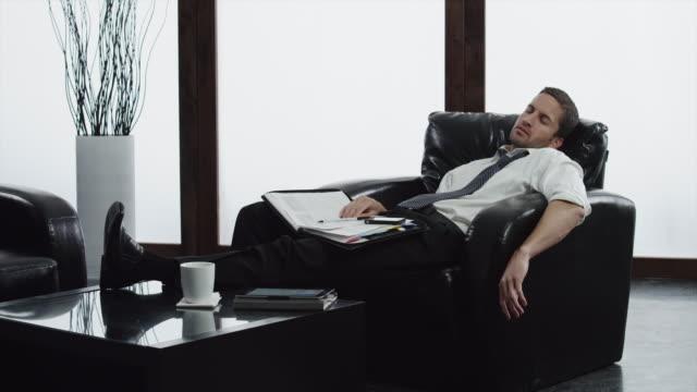 vídeos de stock, filmes e b-roll de ms business man talking nap in lobby / orem, utah, usa - orem utah