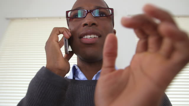 business man talking on cell phone - one mid adult man only stock videos & royalty-free footage