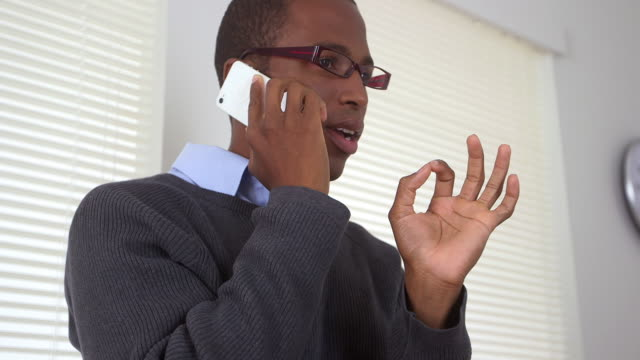 business man talking on mobile phone - one mid adult man only stock videos & royalty-free footage