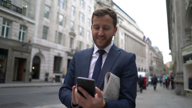 business man texting on his phone outside - formal stock videos and b-roll footage