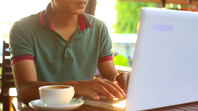 Business man typing on laptop