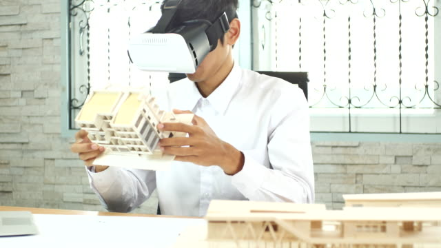 business man use virtual reality headset at home office