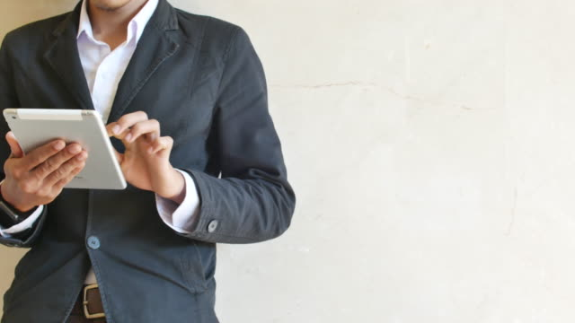 Business man uses his digital tablet in office