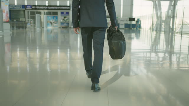 business man walking and running in airport. - full suit stock videos & royalty-free footage