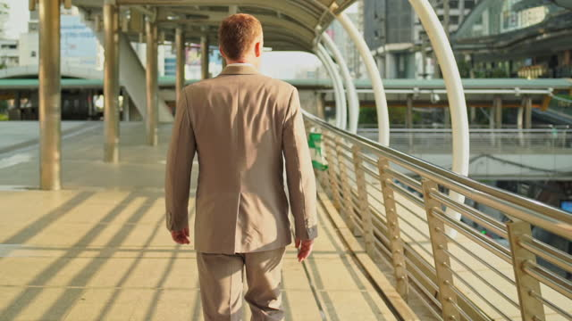 business man walking in city outdoor sunset. business man with suit lifestyle in city. - 50 54 years stock videos & royalty-free footage