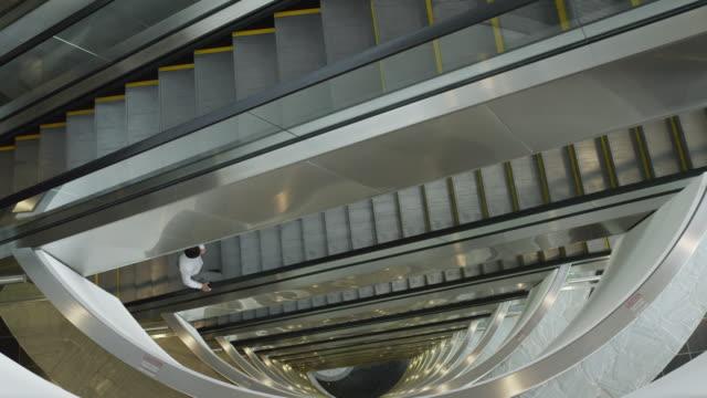 ws ha business man walking up broken down escalators / las vegas,nevada,usa - escalator stock videos & royalty-free footage
