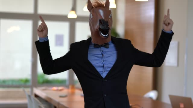 business man with horse mask dancing at office - disguise stock videos and b-roll footage