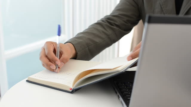 Business man working and writing document