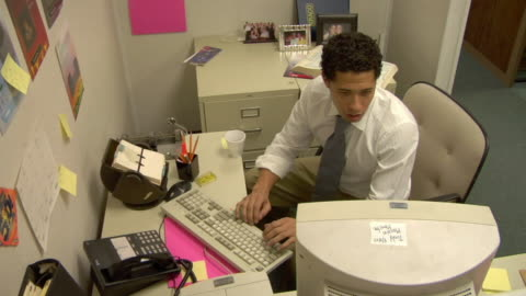 ha, ms, business man working on computer in office, spilling coffee on leg, compton, california, usa - stained stock videos & royalty-free footage