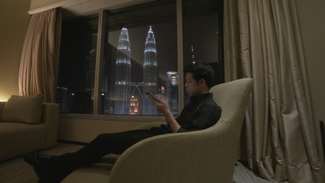 business man working with mobile device in the hotel - malaysia stock videos and b-roll footage