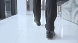 SLO MO DS Business mans shoes walking in hallway