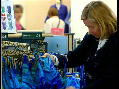 Marks and Spencer Problems Continue LIB ENGLAND London Women shopping in branch of Marks and Spencer