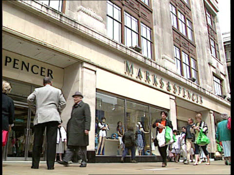 Marks Spencer Clothing Contract Ended LIB ENGLAND London people along past marks Spencer store Shoppers along inside store ZOOM IN
