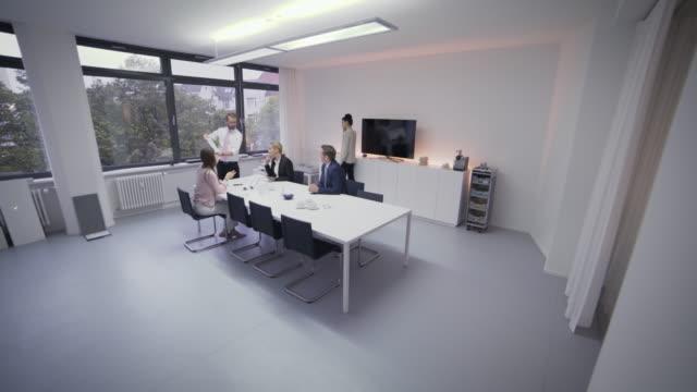 business meeting and presentation in conference room - skjorta och slips bildbanksvideor och videomaterial från bakom kulisserna