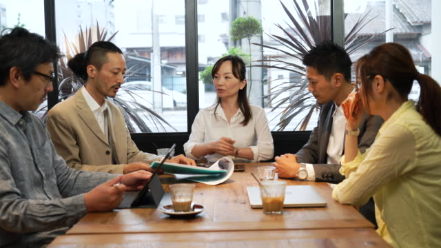 business meeting at cafe - business meeting stock videos & royalty-free footage