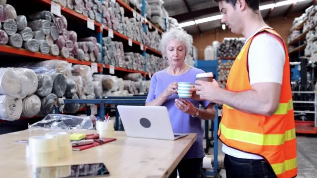 business meeting in a distribution warehouse. - cup stock videos & royalty-free footage
